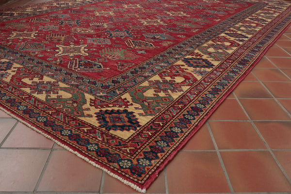 Hand knotted in northern Afghanistan this Kazak rug is ideal for standing furniture on with its all over design.