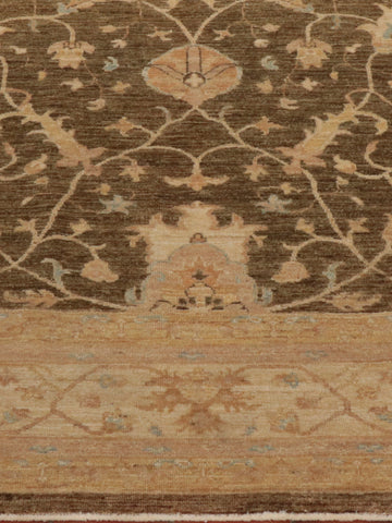 Fine Afghan Ziegler carpet is soft green, gold and cream colourings.