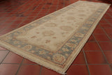 A lovely example of an Afghan Ziegler with a very light cream central ground and a main border of soft blue. This runner would look great on an upstairs landing or bedroom where the use might be a little lighter. The cream may struggle in a main hallway. It is a hand knotted runner made from wool on a cotton foundation