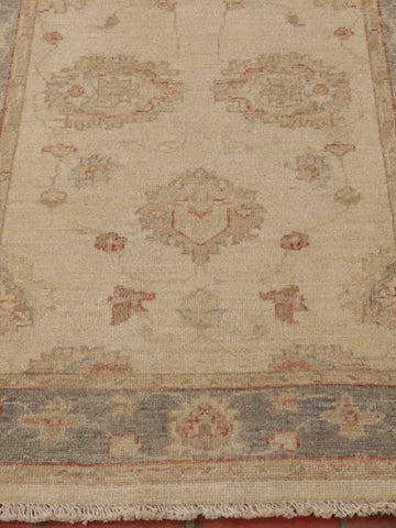 A hand knotted very soft pale coloured Afghan Ziegler runner with blue
