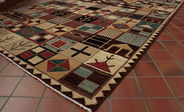 This contemporary Afghan rug has been made using the traditional methods.