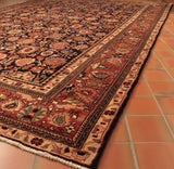 With the dark blue background and brick red border this Persian carpet is ideal for hard wear.