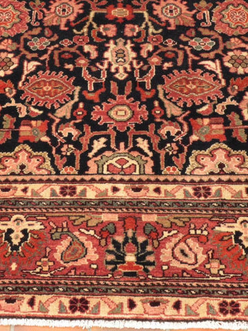 A traditional hand made Persian carpet from northwest Iran in an allover design.