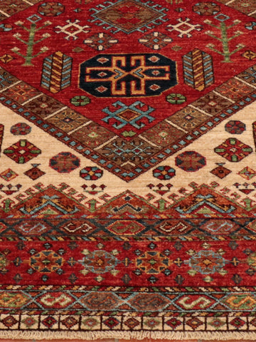 Afghan Shirvan carpet in rich earthy colours and geometric design.