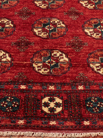 Afghan Ersari rug in traditional colour with elephants foot design
