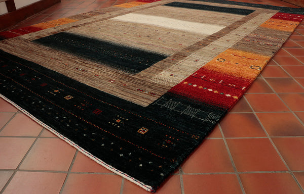Hand knotted in India this very dense Gabbeh rug has striking colours and design.