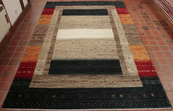 Made by hand in India this Gabbeh rug will certainly make a statement.