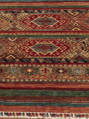 Afghan Samarkand carpet is rich vibrant colours and a more modern design.