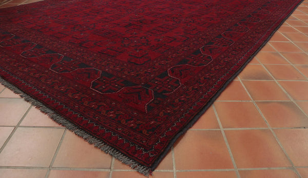 Dark rich red is the main colour used in this Afghan Khan Mohamadi rug.