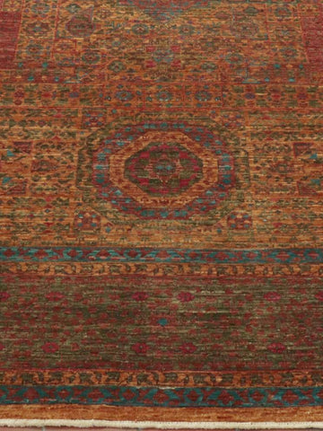 This fine Afghan Mamluk carpet has a golden antique glow to it.