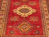 "5'11 x 4'1"" rich warm red ground with central lozenge design in cream/gold and green on this Fine Afghan Kazak rug - 274197"