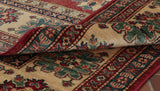 A fine hand made Afghan Kazak carpet in traditional design and colour.