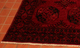 Hand knotted using hand spun wool this Afghan Ersari will add warmth and richness to any room.