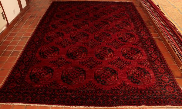 A wonderful rich burnt copper colour Afghan Ersari carpet, made from handspun wool. The colour is a lovely rich burnt copper with navy blue and tiny touches of bright green. This very traditional all over repeating pattern is sometimes call the elephants foot design. The colour and quality of this piece makes it very practical, hard wearing and suitable for any location in the home.