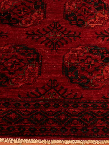 The richness of this Afghan carpet needs to been seen to be appreciated.