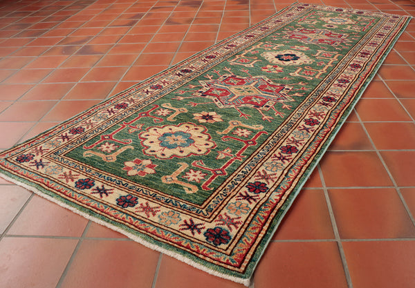 This Fine Afghan Kazak runner is 202 x 72cm (6'8 x 2'4) in size - perfect for a hallway or rooms entrance!