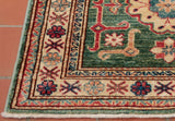 This Fine Afghan Kazak runner features a short fringe that complements the overall piece with its soft beige colour
