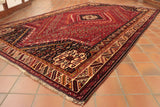 We would describe this Persian hand made tribal rug as semi old. It has some evidence of wear in a very small area.