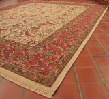 An Indian carpet with a beautiful all over design and an antique look to it.