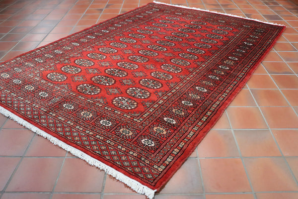 This Bokhara is in a lovely deep red that seems to match most rooms in terms of fitting in.
