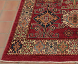 A striking particle hard wearing Afghan Kazak rug.