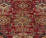 The bold geometric design and the rich colourings point to the fact that it is a Kazak.