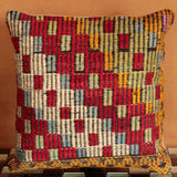 Turkish Kilim cushion featuring a playful, textured design and colour scheme