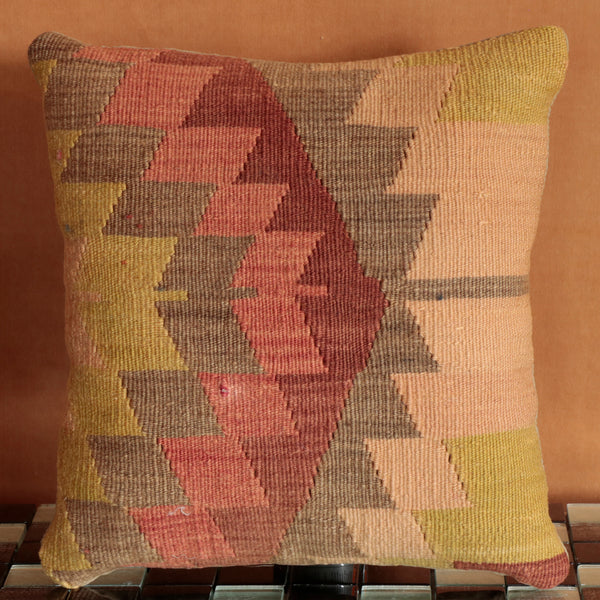 Wonderfully textured Turkish Kilim cushion combining pinks, greens and greys to create a powerful piece - a perfect gift for all