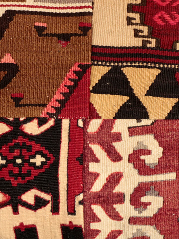 Handmade, naturally dyed and masterfully constructed from multiple pieces of salvaged Kilim