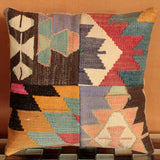 Vibrant, contrasting Kilim patchwork cushion combining several cuts of colourful salvaged Kilim