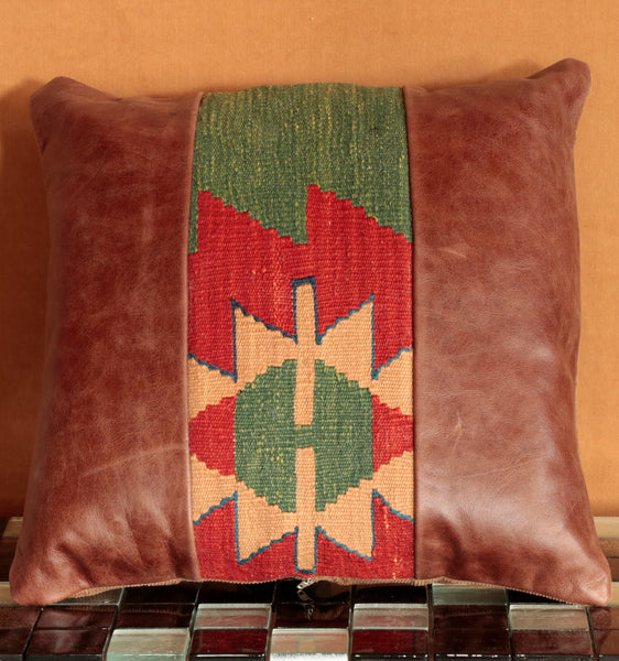 Powerful and vibrant red and green Kilim have been salvaged and set against a lovely natural brown leather.