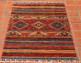 This Samarkand features a more traditional colour palette which is fairly common in this style of rug. It expertly combines rich reds and vibrant blues with earthy brown tones throughout