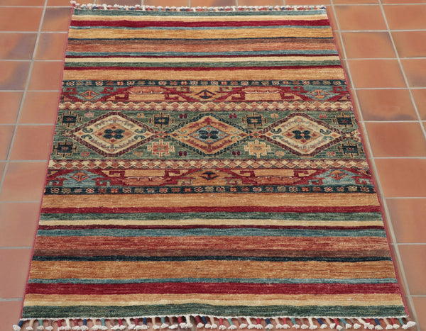 This Samarkand has wonderful shades of scarlet - combined with contrasting maya blue, fern green - whilst being complemented by the earthy brown tones and golden creams