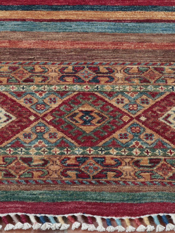 This Fine Afghan Samarkand has been expertly handcrafted from naturally dyed sheep wool