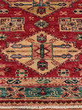 This Afghan Kazak has been finely knotted by hand, using naturally dyed wool - from native Afghan sheep
