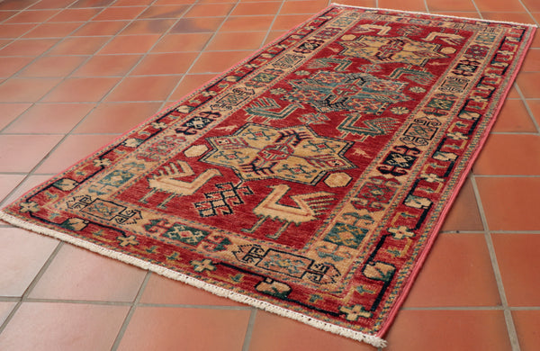 This wondrous Afghan Kazak is 122 x 65cm (4'0 x 2'2) in size.