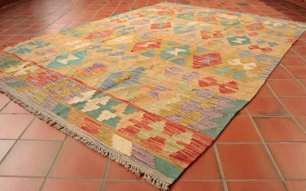 This robust, bright Afghan Kilim is 201 x 148cm (6'7 x 4'10) in size