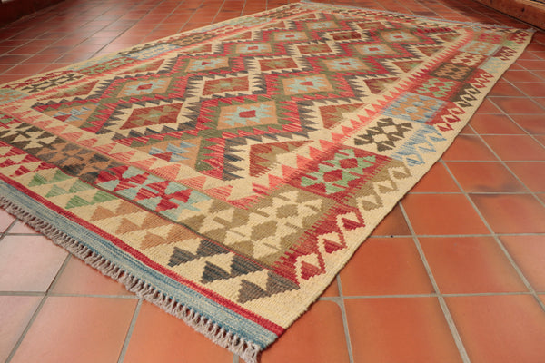 This wonderful Afghan Kilim is 249 x 155cm (8'2 x 5'1) in size.