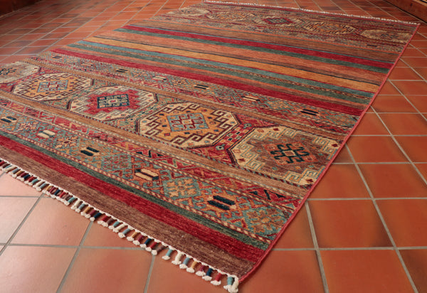 When these Afghan Oriental rugs are finished by the weavers they are then carried accrues the birder into Pakistan where they are sold and finished.