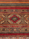 This particular Samarkand possesses a traditional geometric design at either end; in a combination of contrasting rich scarlet reds and soft jades, with touches of maya blue and beige
