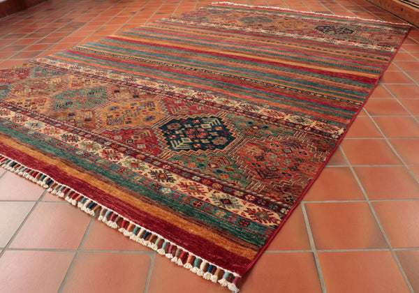This hand knotted Samarkand rug is made in Afghanistan and finished in Pakistan.