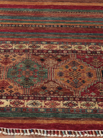 An Afghan Samarkand rug with a wonderful bound fringe producing a multicoloured bobbin effect