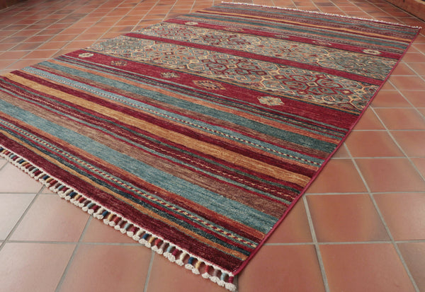 The carpets final stage in Pakistan involves many processes initial tensioning may be undertaken followed by surface clipping herbal washing and finally tumbling.