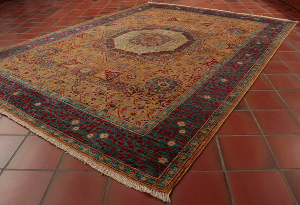 Whilst other Mamluks have a mainly red/orange background, this rug favours a yellow instead.