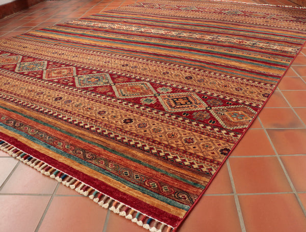 Attractive stripy design with out a traditional border make this rug unusal.