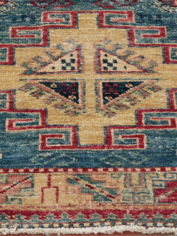 A wondrous Afghan Kazak mat, finely handcrafted from the naturally dyed wool of native Afghan sheep.