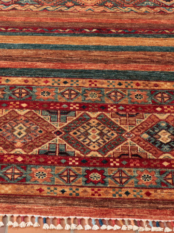 A show-stopping Afghan Samarkand runner, handcrafted from the naturally dyed wool gathered from native Afghan sheep.