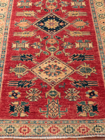 An exquisite, handcrafted Afghan Kazak - finely knotted using naturally dyed wool.