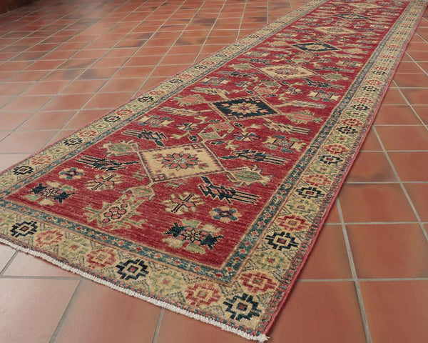 This brightly coloured, playful Kazak runner is 302 x 80cm (9'11 x 2'8) in size - perfect for a statement upon entering ones home.