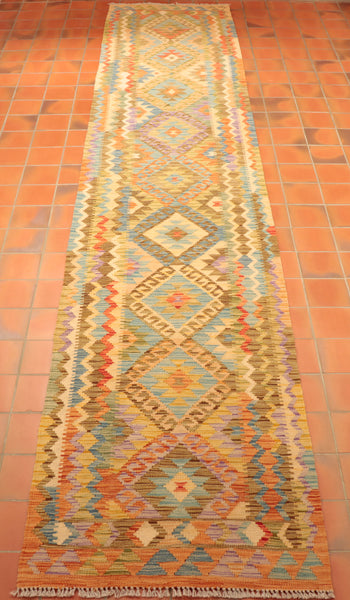 Durable, handmade Kilim made from vegetable dyed wool featuring a wide array of bold and beautiful colours